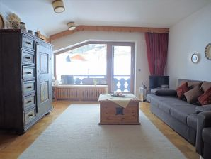 Ferienwohnung Hüttenzauber (412) - Haus Elmauer Weg 12