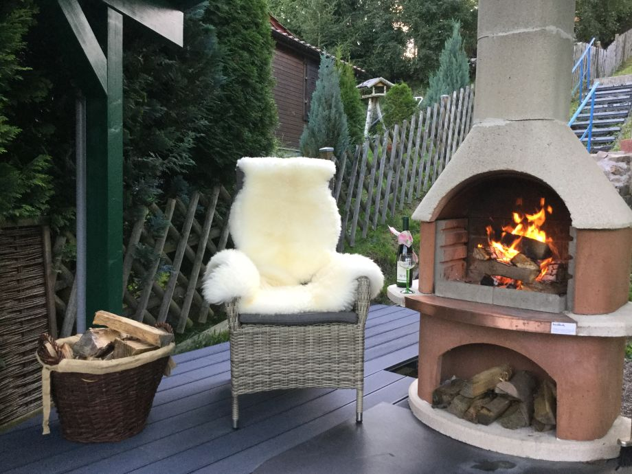 The outdoor terrace with fireplace