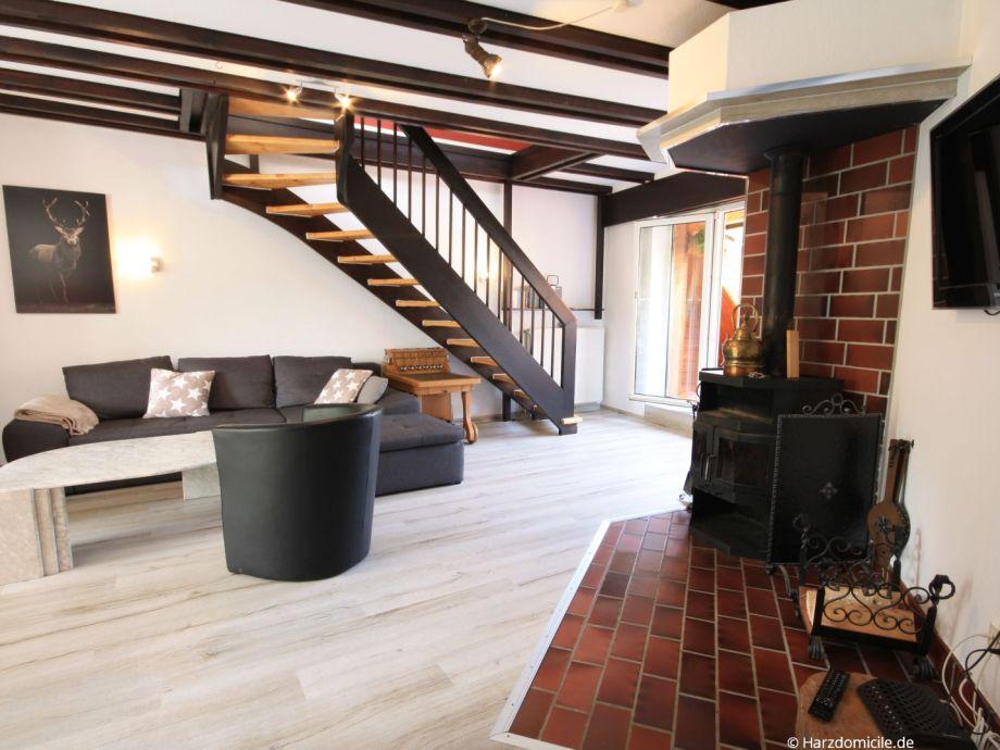 Wohn- /Essbereich mit offener Küche und Kamin