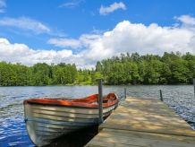 Ferienhaus mit Seeblick, eigenem Steg & Boot