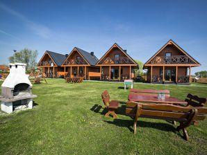 Ferienwohnung Uroczy dom z widok na jezioro tylko 1000 m od morza Idealny dla 9 osób