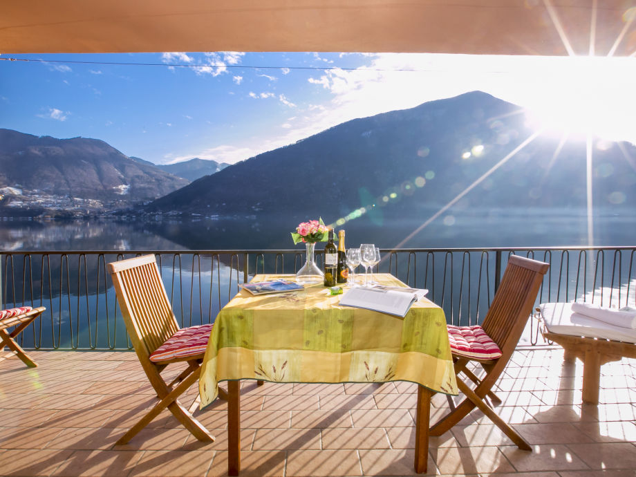 Sunny covered terrace with outside dining space