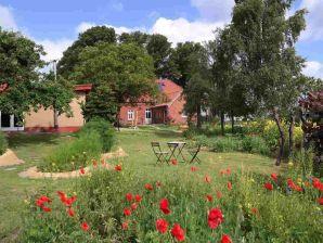 Ferienhaus Kunst 4 Garten