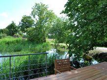 Ferienwohnung Landhaus mit Südterrasse am Teich