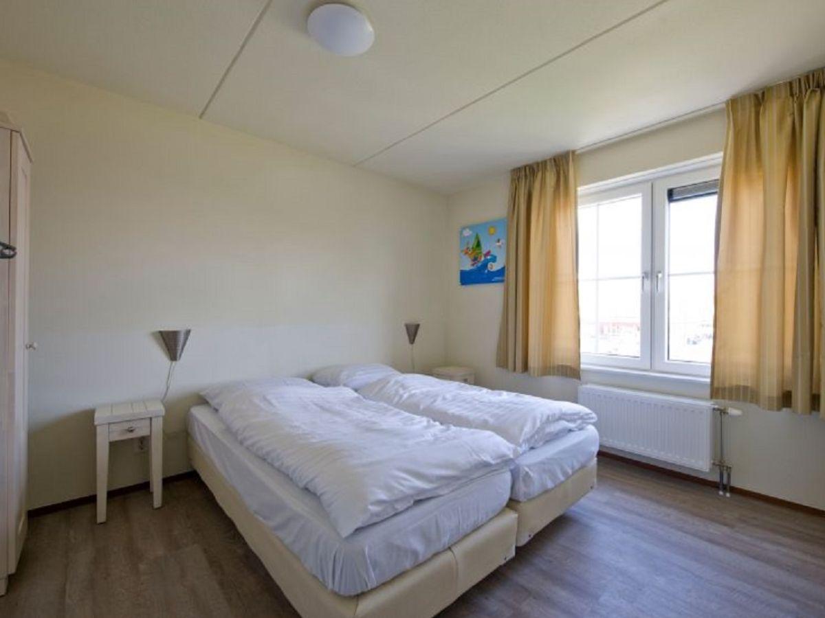 ferienhaus strand en duinen zeeland nieuwvliet firma govilla moderne vakantiehuizen herr. Black Bedroom Furniture Sets. Home Design Ideas