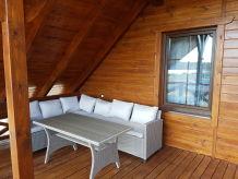 Ferienwohnung Drewniany dom nad jeziorem