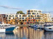 """Ferienwohnung """"First Marina View"""" mit Kamin und Panoramabalkon"""