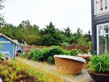 Ferienwohnung Strandhaus EG Garten