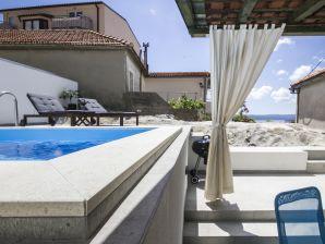 Ferienwohnung Marino mit Pool