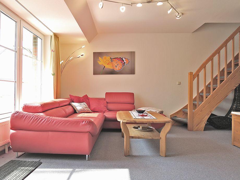 Wohnzimmer mit Schlafsofa Wohnung Schmetterling