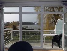 Ferienwohnung Villa Seerosen, Südbalkon, Blick auf Schmachter See