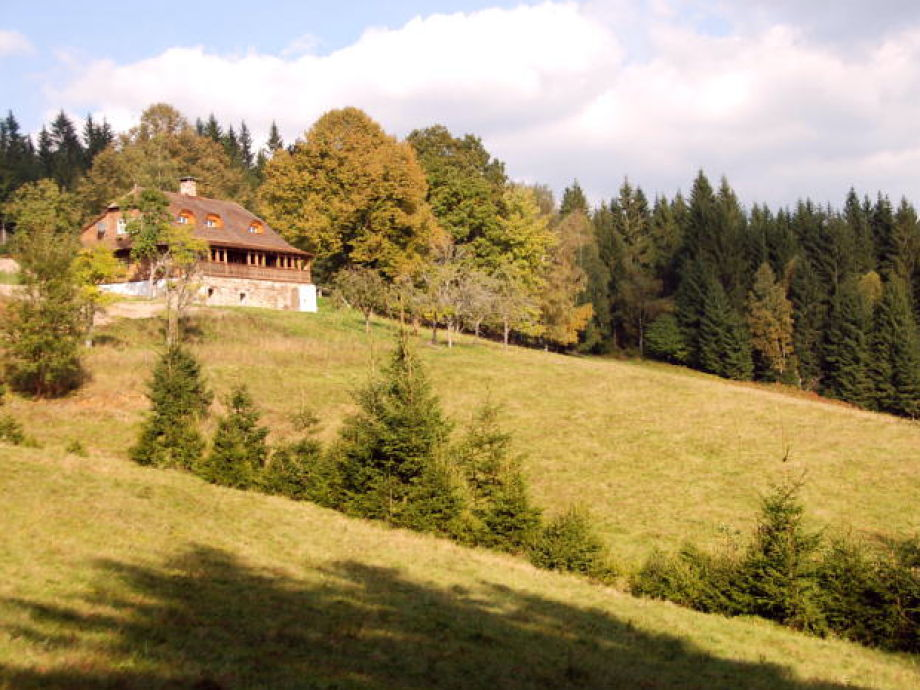 A fabulous Historic Log House surrounded by meadows.