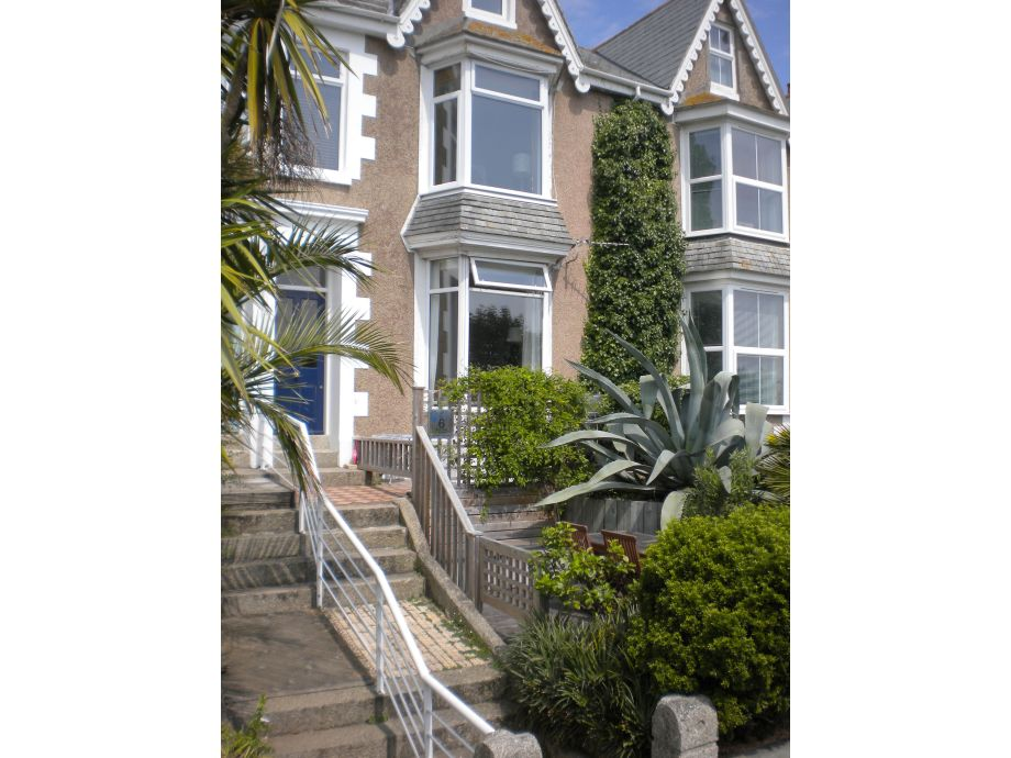 Front of house with maisonette entrance/garden