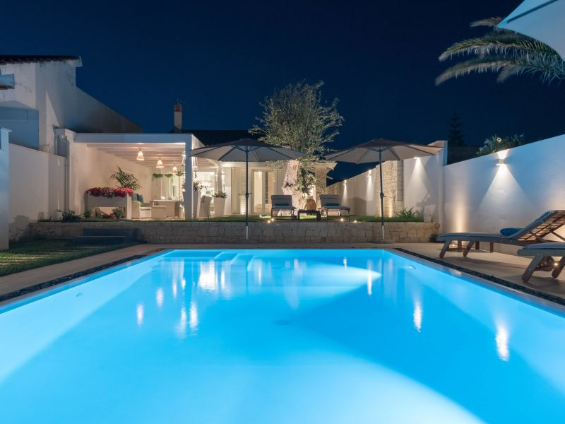 Stylish villa with pool, in front the sea