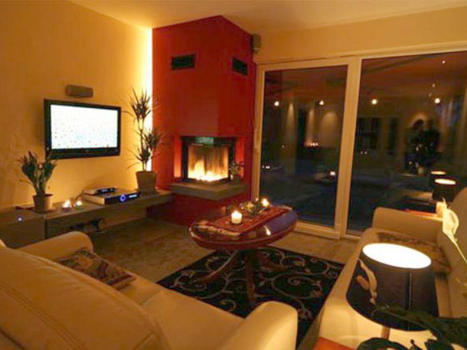 Wohnzimmer mit kamin flatscreen tv