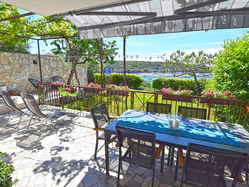 Ferienwohnung Sany mit Meerblick und Garten