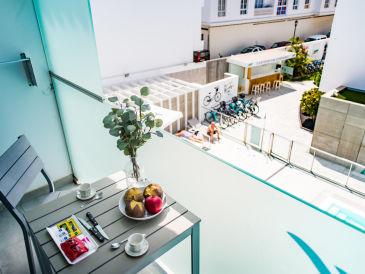 Ferienwohnung BristolSunsetBeach -Poolblick Apartment
