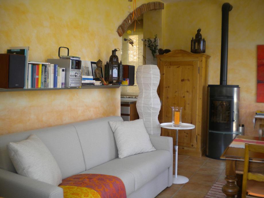 Wohnesszimmer mit Doppelschlafcouch Ausgang Terrasse