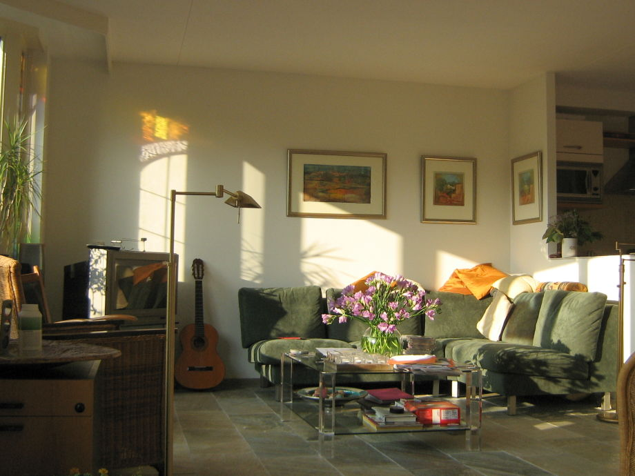 Living room, at the right is the kitchen