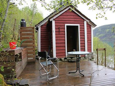 / Blockhaus am Fjord