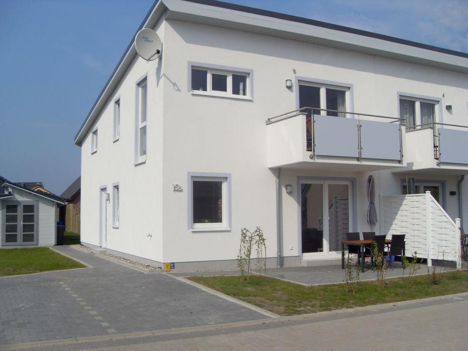 Ansicht EG-Wohnung m. Terrasse + PKW Stellplatz