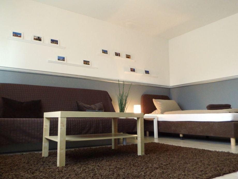 Wohnzimmer mit zusätzlichem Bett