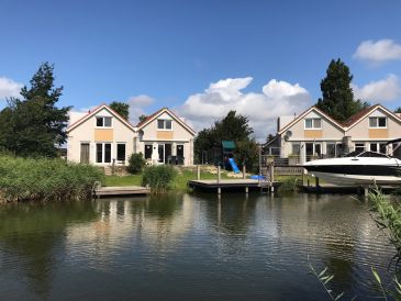 Holiday house Family with sauna and rowing boat