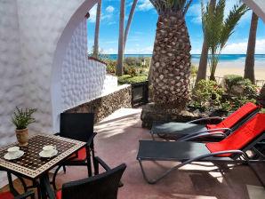 Strand Apartment direkt am Meer - Urlaub unter Palmen