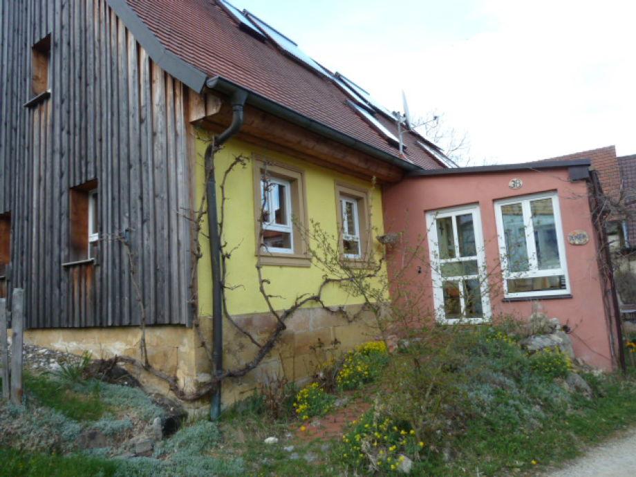 Haus mit Vorbau, um gemütlich zu sitzen
