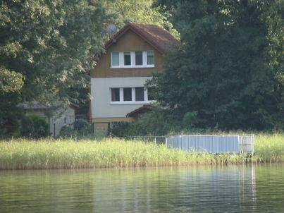 am Storkower See mit Boot und Sauna