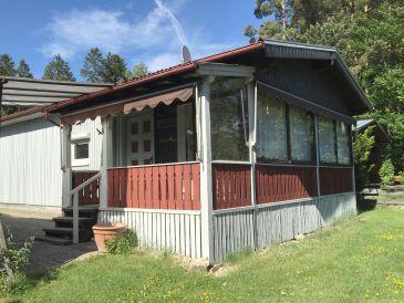 Holz-Ferienhaus mit Wintergarten