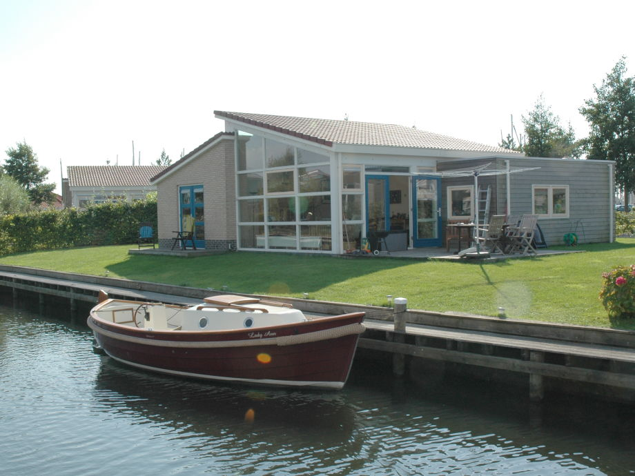 Bungalow at the waterfront with launch boat for rent.