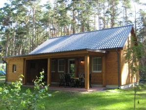 Ferienhaus im Wald am See