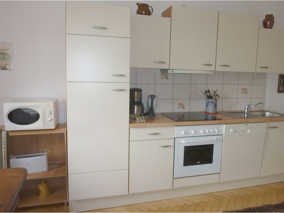 kitchenette fully equipped with dishwasher