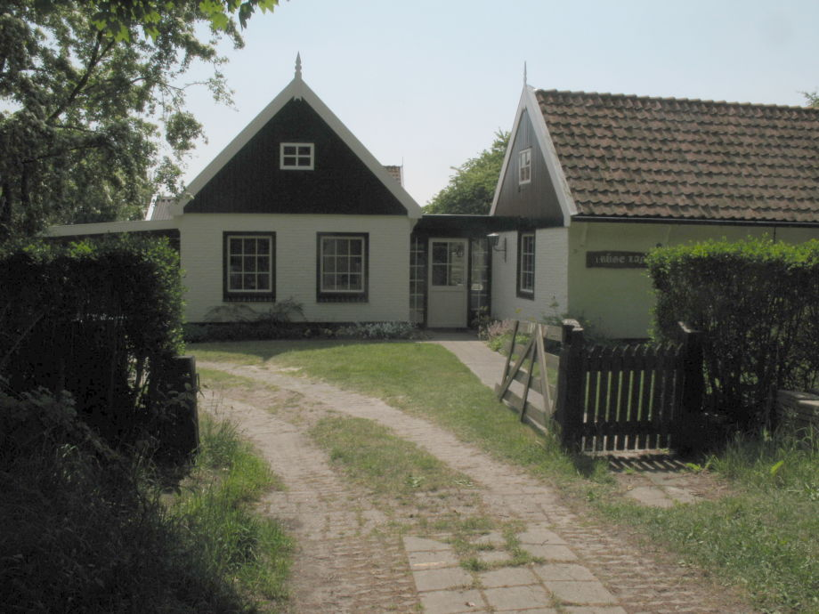 front view of the house in summer time