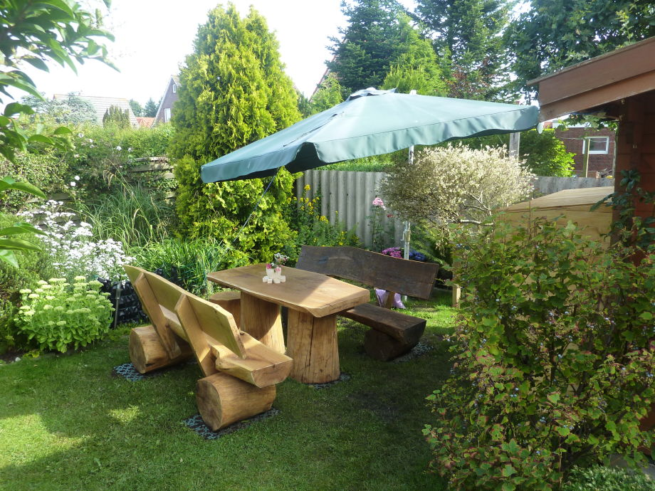 Front garden with rustic wooden bench