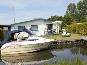 Chalet freistehend am See + schönes Boot zu mieten + strandnah