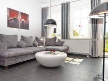 """Ferienwohnung """"Villa To Hus"""" Wohnung 1 mit Terrasse zur Südseite"""