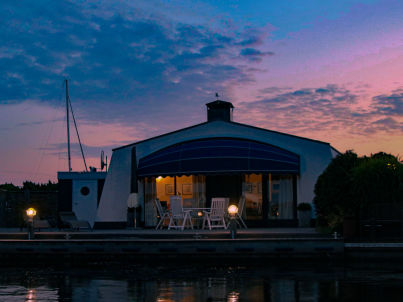 Ferienhaus mit Boot und Bootssteg