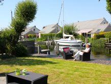 Ferienhaus Scholekster 28 - familienfreundlich - großes Haus und Boot