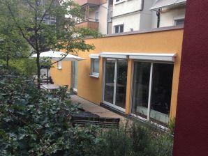 Ferienwohnung Stadtbungalow mit Natursteinterrasse