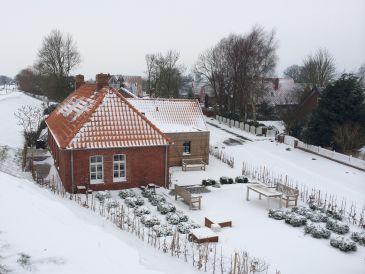 """Ferienhaus """"Oma Geertje"""" im Deichhaus am Greetsieler Hafen"""