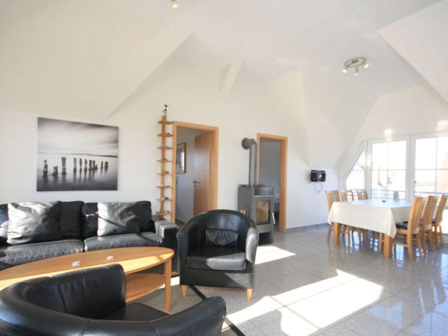 Wohn /Essbereich mit Kamin und offener Küche