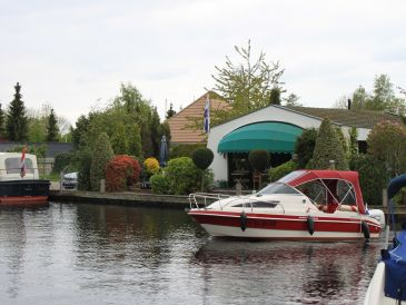 Holiday house with boat and own landing stage