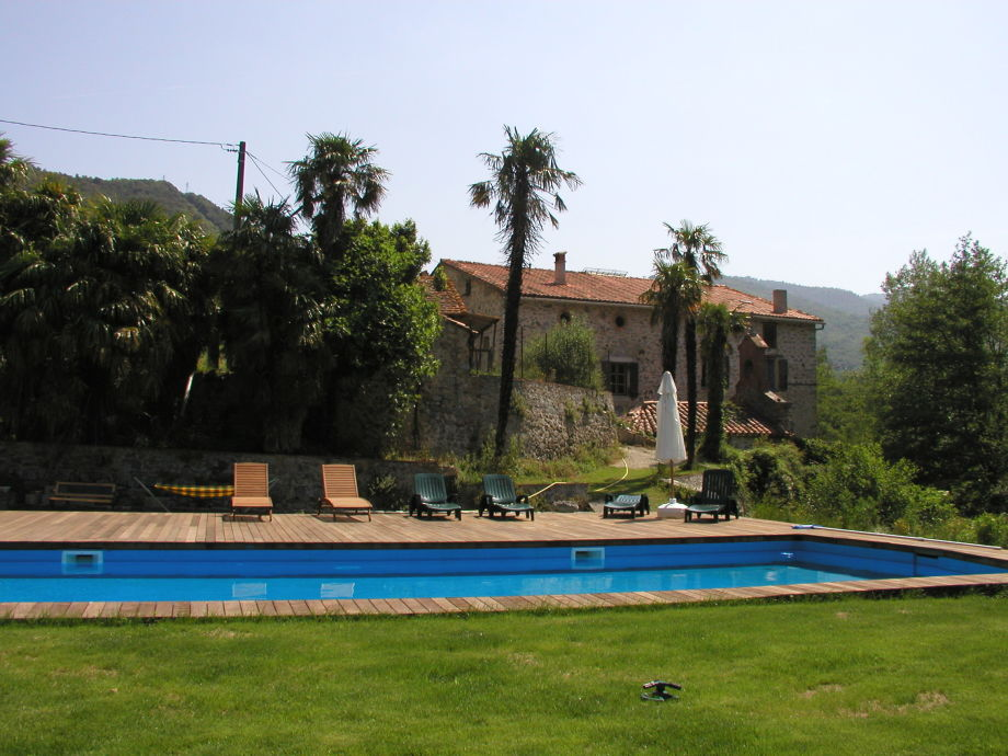 View over the pool with the Manor in the back