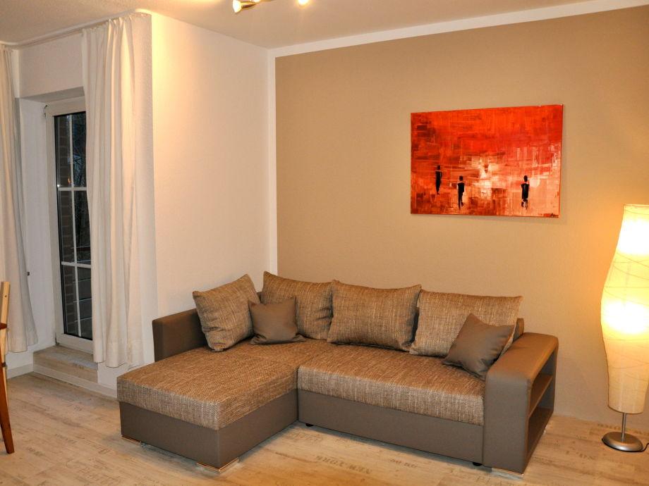 Wohnbereich mit gemütlichem Eck-Schlaf-Sofa