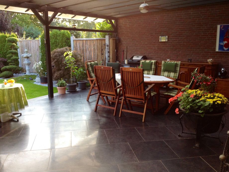 40 sqm covered terrace with barbecue and teak group