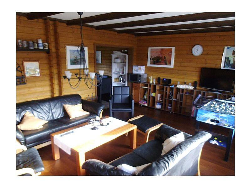 Ferienhaus am See mit Bergblick