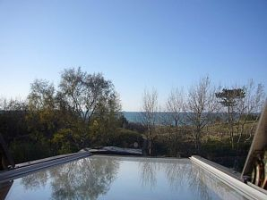 Ferienhaus mit privatem Strandzugang