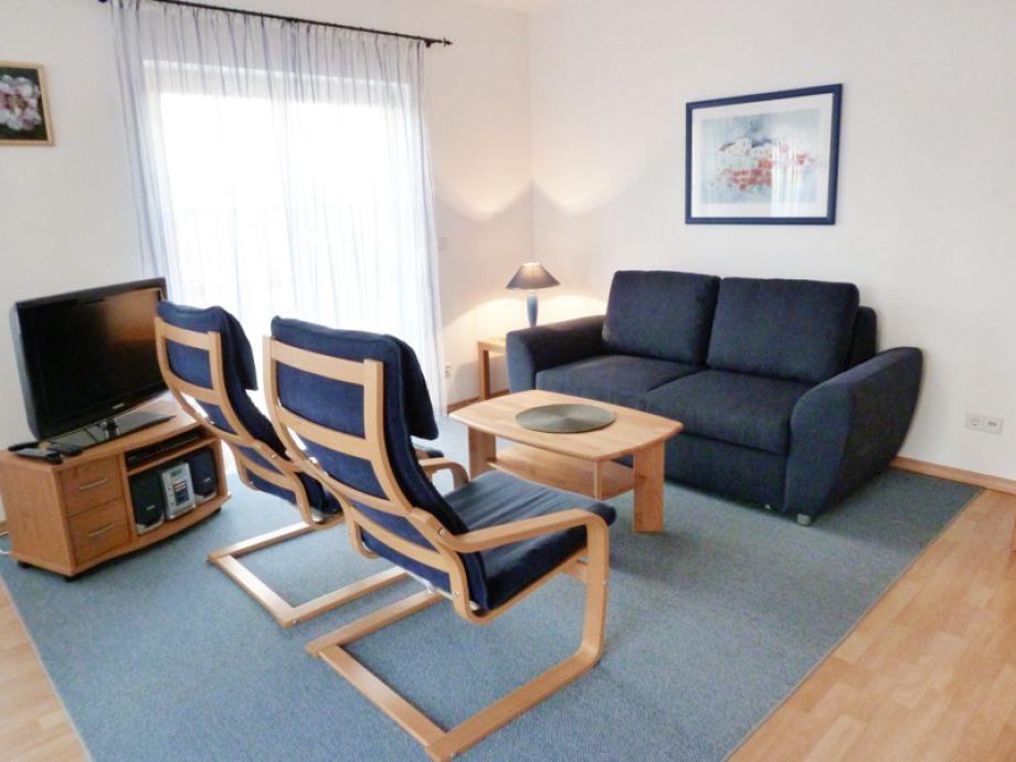Wohnzimmer mit neuer komfortabler Schlafcouch